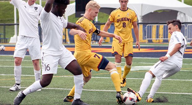 Jacob Schroeter shifts through a pair of Carleton defenders.