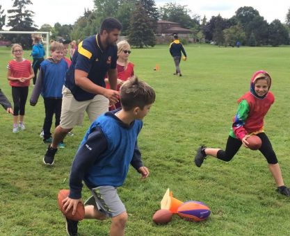 The players ran fun and engaging drills with young students.