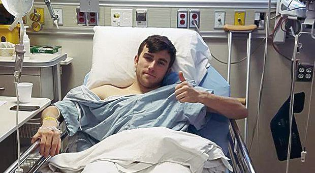 Wilkie gives a thumbs up after his labrum surgery.