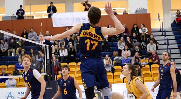 Outside hitter Mitchell Neuert (17) goes up for a spike against McMaster.