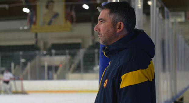 Brett Gibson (above) has coached the men's hockey team for 12 years.