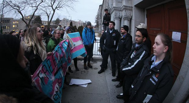 Protesters squared off against Campus Security outside Grant Hall on Monday.