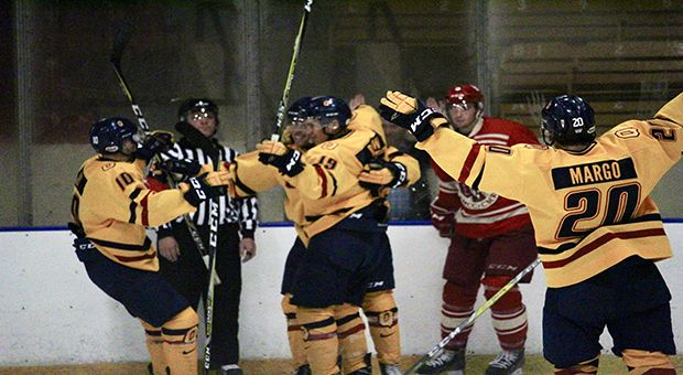Forward Eric Margo celebrates with teammates against RMC last Wednesday.