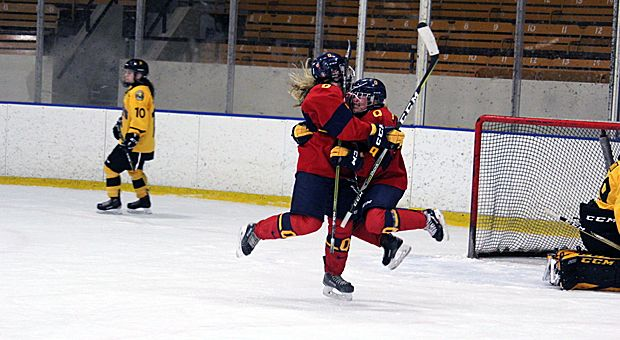 Forward Caroline DeBruin (right) celebrates after scoring the game-winning goal on Saturday night against Waterloo.