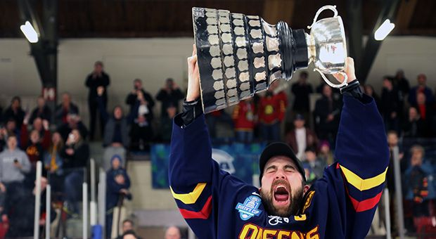 Captain Spencer Abraham hoists the Queen's Cup on Saturday night at the Kingston Memorial Centre.