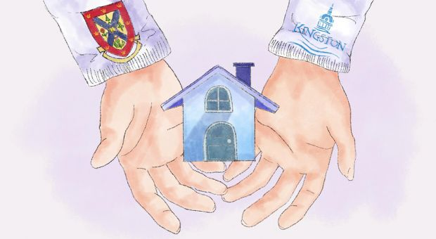 Two hands holding a house