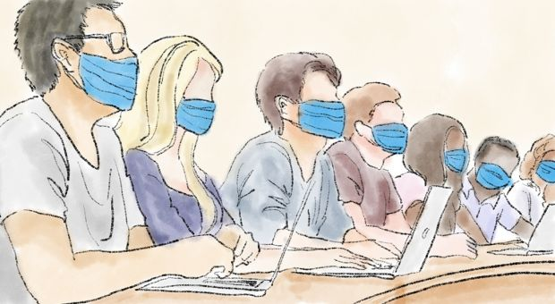 students wearing masks in a classroom