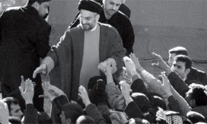 Abdul Aziz al-Hakim, the leader of SCIRI, the dominant party in Iraq's ruling coalition, greets his supporters after the Eid al-Adha prayer in Baghdad, Iraq, Sunday, Dec. 31, 2006. A day after the former Iraqi president Saddam Hussein was executed, al-Hakim led the Shiite Eid prayers near his party's headquarters in Baghdad, and congratulated the Iraqi people on the execution of the former dictator.