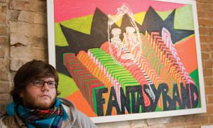 "Local artist and musician Paul Saulnier in front of his painting ""FantasyBand."""
