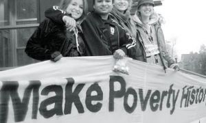 Make Poverty History wrapped a white banner around Stauffer Library on Oct. 17 in honour of the International Day for the Eradication of Poverty.