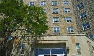 MCRC President Alexis Meyerman in front of Victoria Hall, the largest campus residence.