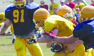 Gaels players run full-contact drills during a training camp practice.