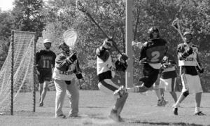 Christian Rice leaps to unleash a shot on his way to a hat trick against Laurier on Saturday. The Gaels won 10-4.