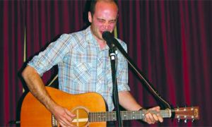 Andre Ethier, normally of The Deadly Snakes, gives a solo acoustic set at The Grad Club as part of the Tall Tales Tour.