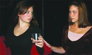Two cast members swill their emotions in Ghost of the Tree, now playing at Theatre 5 on King Street West.
