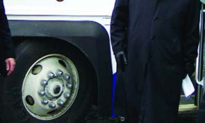 Stephen Harper struts out of his Tory-mobile.