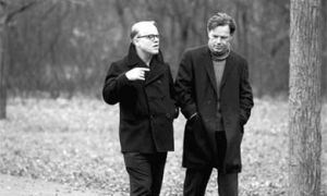 Truman Capote (Philip Seymour Hoffman) and Jack Dunphy (Bruce Greenwood) take a stroll in Capote.