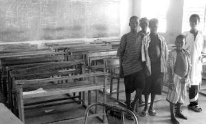 Students in Saponé, Burkina Faso, stand in their classroom, where they learn reading, writing and math in both French and Mooré. Douma helped test the students in each subject and create a database of all their scores.