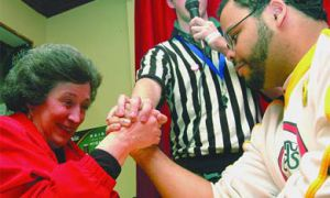A faceoff between Principal Karen Hitchcock and Golden Words Co-Editor in Chief Jon Thompson headlined Queen's Oxfam's Control Arms arm wrestling competition on Monday.