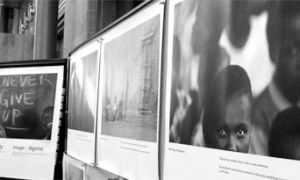 These photos on exhibit in Stauffer Library are meant to illustrate the experiences of people with AIDS.