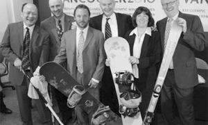 Queen's grads Jeff Chan (far left), Terry Wright (middle with snow board), and John McLaughlin (far right) are all smiles after being appointed to VANOC's leadership team