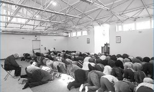 Muslims pray facing east during Friday prayers at the Islamic Society.