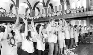 This year's frosh, pictured above cheering and chanting, should try to burst the campus bubble.
