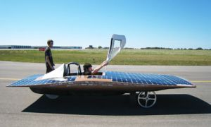 Eric Frazier and driver Kevin McHale get ready for a test-run in Aurum, the Queen's Solar Vehicle Team's car. The team is competing in the World Solar Challenge in Australia next week, racing over 3,000 kilometres from Darwin to Adelaide.