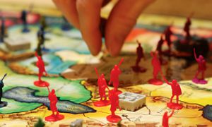 Avid gamers play History of the World, one of the many skill-demanding games available for today's more advanced board game player.