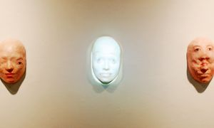 Miya Turnbull's nine paper-mâché masks unravel her facial features and present multiple representations of herself.