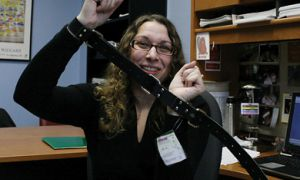 Psychology professor Caroline Pukall demonstrates the use of a trick belt.