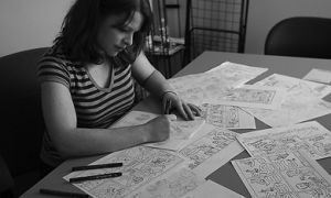 Erin Robinson graduates this spring after four years of drawing cartoons for Golden Words.