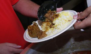 Members of Queen's University Muslim Students' Association serve up a meal after sundown.