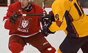 Queen's defenceman Mike Bushby battles McGill's Alexandre Picard-Hooper Saturday. The Gaels lost 4-1.
