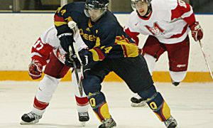 Queen's forward Billy Burke is pursued by McGill's Louis-Simon Allaire (left) and Chris Churchill-Smith Saturday.