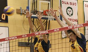 Gaels' hitters Sam Pedlow (8) and Joren Zeeman (5) go up for a block against the Laurier Golden Hawks Saturday night.