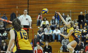 Queen's outside hitter Lorna Button goes for a kill Saturday.