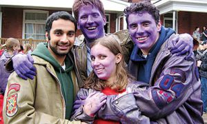 Jignesh Patel, John Mould, Jeannette Comeau and Jon Abela, all Sci'04, enjoying their time at Homecoming.