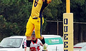 Queen's wide receiver Blaise Morrison makes a leaping catch to set the Gaels up for another touchdown on Saturday's Fauxcoming win over the York Lions.