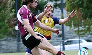 Fly-half Graeme Dibden attempts to block a McMaster kick during Saturday's 59-5 romp over the Marauders at Kingston Field.