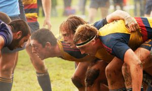 Hooker Mason Curtis (centre) and props Shayne Dolden (left) and Tom Binczyk (right) set up for a scrum against the Mustangs on Saturday in London. The Gaels won 13-12, marking the first Queen's men's rugby win over Western since 2001.