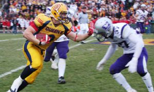 Running back Marty Gordon stiff-arms away the challenge of Western corner Jamie Symianick during Saturday's Yates Cup win over the Mustangs. Gordon picked up 81 rushing yards on the day, playing in tandem with running back Jimmy Therrien.