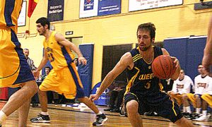 Gaels' guard Baris Ondul drives for Ryerson's basket during Queen's 71-65 win at Bartlett Gym on Saturday.