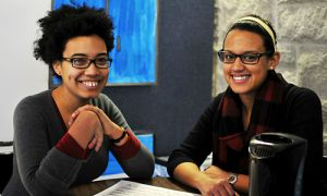 Black History Month Co-ordinator Anna Thomas and cultureSHOCK! Managing Editor Christina Hermanns relax in cultureSHOCK!'s art installation in the JDUC. Hermanns designed the installation.