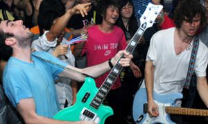 Bassist Dean Baxter and lead singer Menno Versteeg of Montreal band Hollerado, seen here playing a show during one of their two tours of China in the past year.