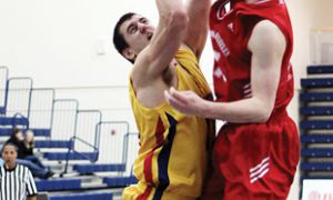 Forward Jordan Kirschberger gets his shot blocked by a Royal Military College defender in the Gaels' win on Feb. 20. The Gaels then beat Ryerson in the first round of the playoffs before being knocked off by the Gee-Gees in the quarterfinal.