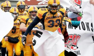 Gaels' linebacker Shomari Williams enters the field at last year's Vanier Cup. His performance in the playoffs cemented his number one status.