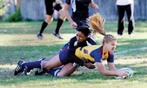 Winger/Centre Sarah Pathak is brought down after scoring a try in the Gaels' 44-5 OUA Quarterfinal victory.
