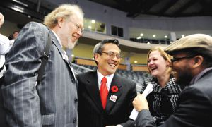 Ted Hsu celebrates his Liberal nomination win with supporters. From left to right: Fred Faust, Ted Hsu, Queen's Students Paula Mosbrucker and Jerome James.