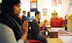 Visitors at the Kuluta Buddhist Centre on Wellington St. participate in a meditation led by Kelsang Donsang on Tuesday night.